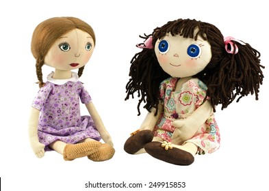 Two rag dolls isolated on white