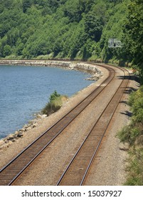 Two railroad lines by the water