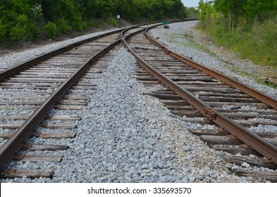 Two railroad tracks merge into one.