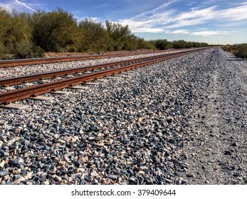 two railway tracks converge to a point at the horizon
