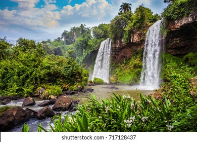 Two rapid powerful waterfalls from the Iguazu Falls in Argentina. The concept of extreme and ecological tourism. Picturesque ledges form the famous waterfalls