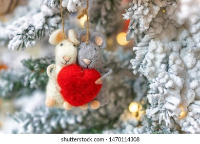 two rats hanging on a Christmas tree, holiday decoration.