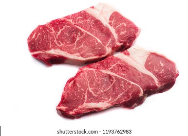two raw beef Chuck steaks isolated on white background