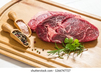 Two raw dry aged entrecote, top view, close up