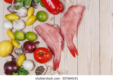two raw fishes of bass with lime,