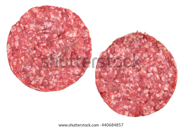 Two raw red meat burgers for hamburgers of minced ground beef or pork ready for cooking isolated on white background, top view