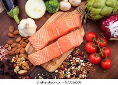 Two raw salmon fillets on wooden background