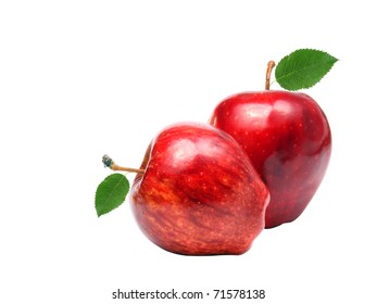 Two red apples with green leafs isolated