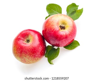 Two red apples with leaves isolated on white background