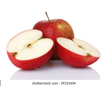 Two red apples with one sliced in half. They are Haralsons, but look like fuji or gala as well.
