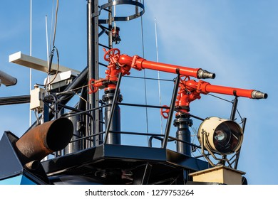 Two red and black water cannons aboard on a fire boat in Italy