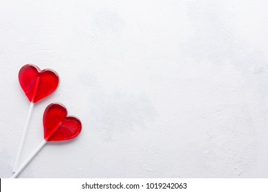 Two red Candy hearts on white concrete background. Minimal love concept. Romantic Style.  Creative for colorful greeting card with copy space.