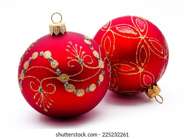 Two red christmas balls isolated on a white background
