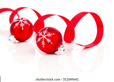 two red christmas decoration balls with satin ribbon, isolated on white background
