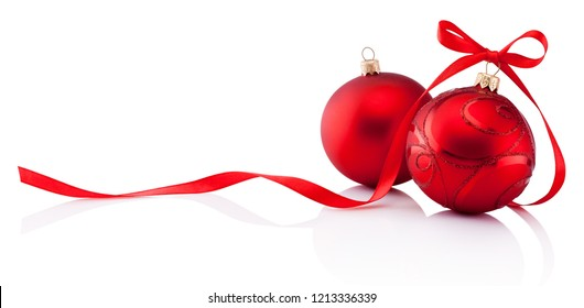 Two red Christmas decoration baubles with ribbon bow isolated on white background