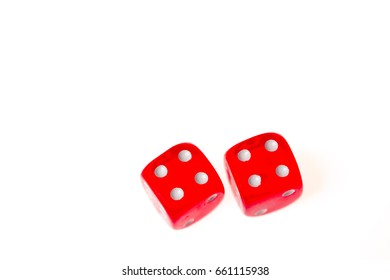 Two red dice both showing a four on the upper face, isolated against a white background