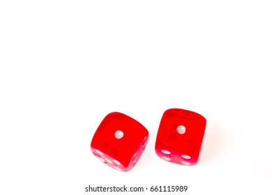 """Two red dice both showing one on the upper face (also known as """"Snakes Eyes""""), isolated against a white background"""