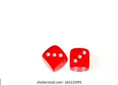 Two red dice both showing a three on the upper face, isolated against a white background