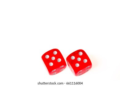 Two red dice both showing a five on the upper face,isolated against a white background