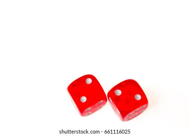 Two red dice both showing a two on the upper face, isolated against a white background