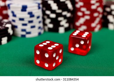 two red dice on green table, close up