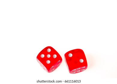 Two red dice showing a five and a two isolated against a white background