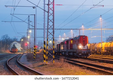 Two red diesel freight locomotives in Nymburk, Czechia