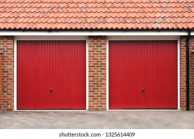 Two red doors in a modern residential garage