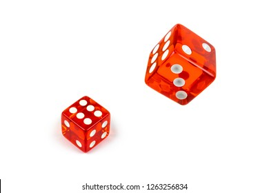Two red glass dices isolated on white. Six and flying in the air, view from above.