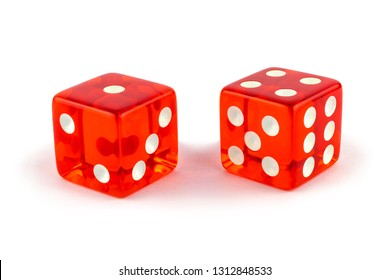 Two red glass game dice very close up isolated on white background. One and four with a shadow.