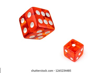 Two red glass playing dice isolated on a white background. Alone and flying in the air, top view.