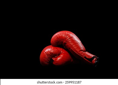 Two red gloves on a black background