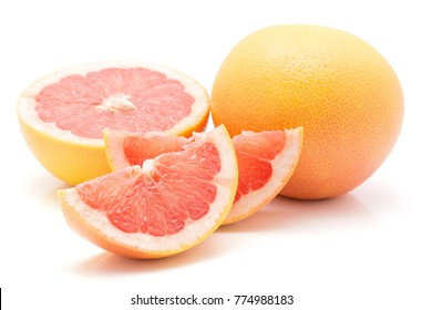 Two red grapefruit slices, one half and one whole isolated on white background