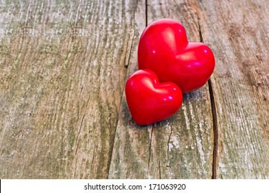 two red heart on wood
