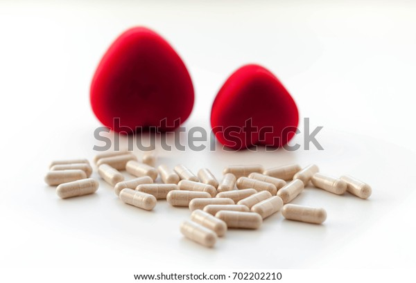two red hearts and capsules medication