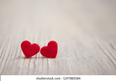 two red hearts on a light wooden background. holiday. congratulations. St. Valentine's Day. wedding.