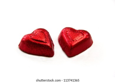 Two red hearts shape candy with white background