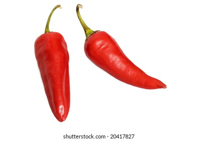 Two red hot jalapeno peppers over white