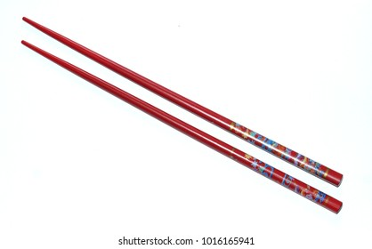 Two red japanese chopsticks (hashi - jap.) isolated on white background