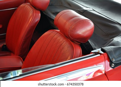 Two red leather seats of convertible car
