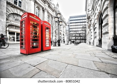 two red phone booths on the street