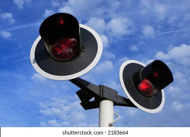 Two red signal lights on blue sky