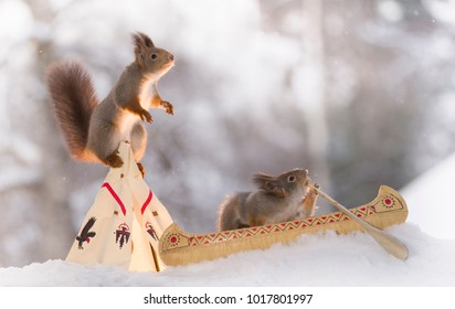 two Red squirrels with a teepee and a canoe