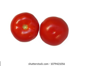 Two red tomatoes on isolated white background