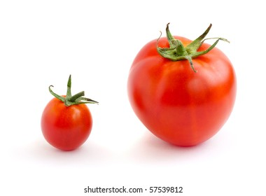 Two red tomatoes, small and big