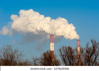 Two red and white pipes from the factory. Of the pipes out the steam. The concept of the environmental problem