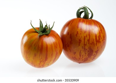 Two red zebra tomatoes.