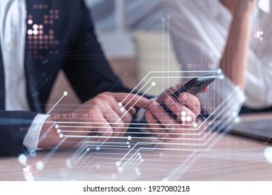 Two research and development specialists brainstorming on project to create a new approach to develop software to improve business . Working with phone. Tech hologram icons. Formal wear.