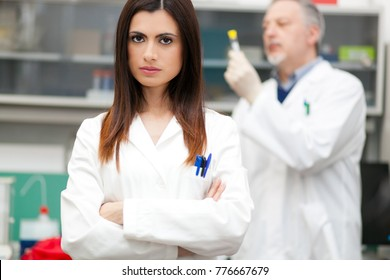 Two researchers at work in a laboratory