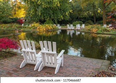 Two resting chairs on the lake in the city park
